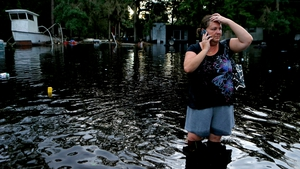 Resident Lynne Garrett surveys the damage outside her home in St. Marks, Florida