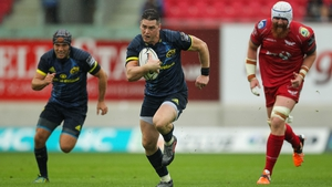 Ronan O'Mahony on his way to scoring a try for Munster in Wales
