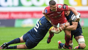Scarlets' Scott Williams is tackle by Niall Scannell and Jack O'Donoghue of Munster