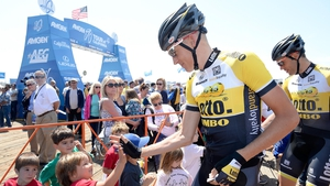 Stage winner Gesink greets young fans before the start of racing