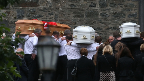 The coffins are taken into St Mary's Church in Castlerahan, Co Cavan