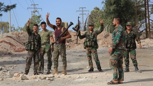 Syrian soldiers on the southern outskirts of Aleppo after regime forces retook control of three military academies from rebel fighters