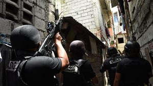 Philippine police SWAT personnel carry out a search of residences in Pasig City, Manila