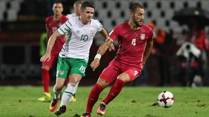 Republic of Ireland's Robbie Brady tackles Nemanja Gudelj of Serbia