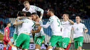 Ireland players mob Daryl Murphy in Belgrade