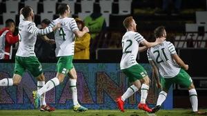 Ireland players mob Daryl Murphy