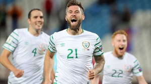 Daryl Murphy wheels away in celebration with John O'Shea (L) and Stephen Quinn