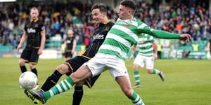 Shamrock Rovers' Dean Clarke battles Ronan Finn of Dundalk in April