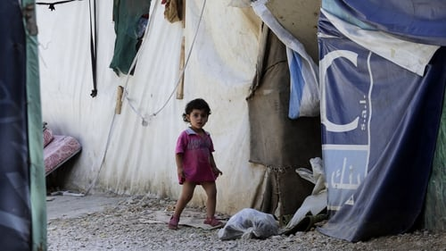A Syrian child at an unofficial camp for refugees in the Bekaa Valley, central Lebanon