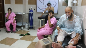 Syrians suffering from breathing difficulties being treated at a make-shift hospital in Aleppo