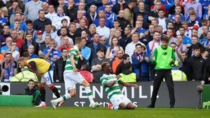 Moussa Dembelle celebrates his opening goal