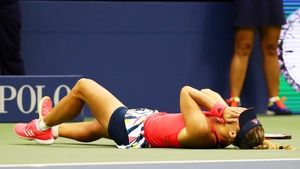 Angelique Kerber falls to the ground following victory