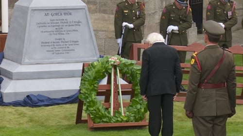 President Higgins lays a wreath at new famine memorial