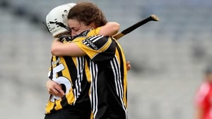Julie Ann Malone (R) embraces Shelly Farrell at the final whistle