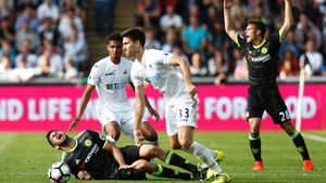Diego Costa reacts following a challenge against Swansea