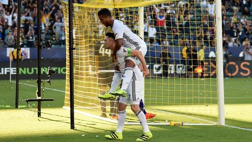 Robbie Keane celebrates his goal with Giovani dos Santos