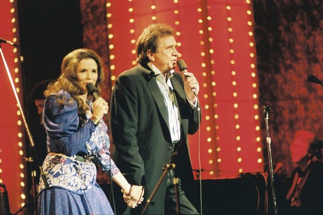 June Carter Cash and Johnny Cash on stage at the Cork Opera House (1989)