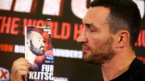 Wladimir Klitschko poses with an image of Tyson Fury