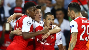Alexis Sanchez is congratulated after his late leveller