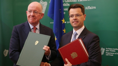 Charlie Flanagan (l) James Brokenshire signed the agreement this afternoon