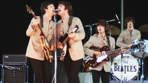 The Beatles playing at Shea Stadium