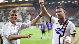 Stephen Kenny holds Ciaran Kilduff's arm aloft as Dundalk acknowledge the role played by their travelling supporters