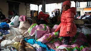 A family from Eritrea is pictured at a makeshift camp in Paris