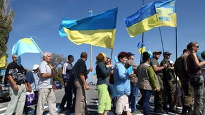 Crimean Tatars and Ukrainian activists block the road at a checkpoint between Ukraine and Crimea during a protest last year