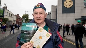 Dan Hoban from Newport in Mayo outside Croke Park with a copy of the 1951 All-Ireland final programme, which he attended, alongside today's programme