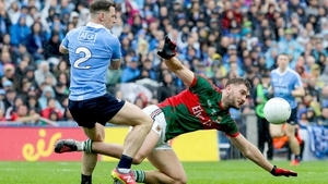 Philly McMahon and Aidan O'Shea compete for the loose ball