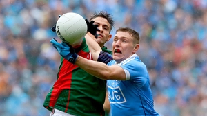 Mayo's Jason Doherty and John Small of Dublin battle for possession