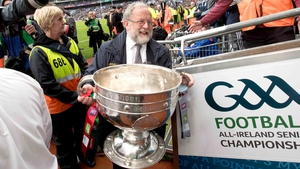 Not today. Jerry Grogan takes the Sam Maguire back inside after the drawn match