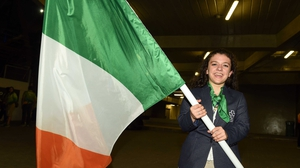 Nicole Turner prepares to carry out the Irish flag at the Rio Paralympics closing ceremony