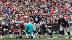 Jimmy Garoppolo #10 of the New England Patriots communicates at the line of scrimmage