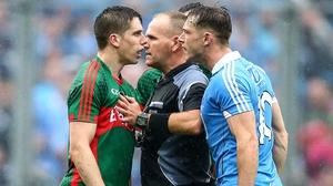 Referee Conor Lane separates Dublin's Paul Flynn and Lee Keegan of Mayo