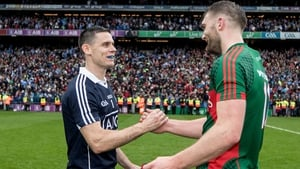 Stephen Cluxton embraces Aidan O'Shea at the final whistle