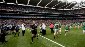 Dublin and Mayo players are separated after they both emerge from the tunnel at the same time