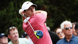 Rory McIlroy hits his tee shot on the seventh