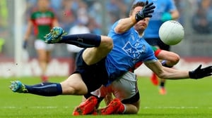Paddy Andrews of Dublin loses his footing while trying to collect a ball during the drawn All-Ireland final