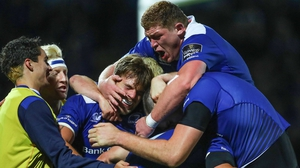 Leinster's Jordi Murphy and Tadhg Furlong celebrate with try scorer Josh van der Flier