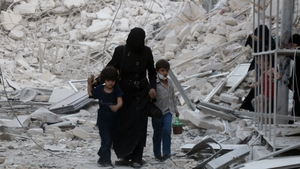 A Syrian family leaves the area following a reported airstrike