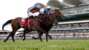 Seamie Heffenan got Brave Anna (R) up on the outside to win the Cheveley Park Stakes