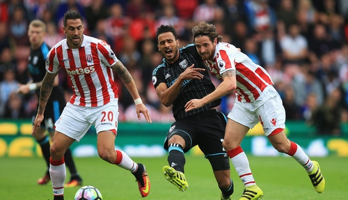 Stoke scorer Joe Allen challenges Nacer Chadli