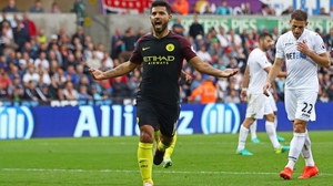 Sergio Aguero celebrates scoring from the spot at the Liberty Stadium