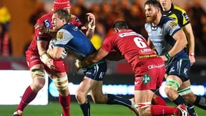 Kieran Marmion of Connacht is tackled by Aaron Shingler of Scarlets