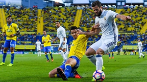 Nacho Fernandez of Real Madrid CF is tackled by Vicente Gomez of UD Las Palmas