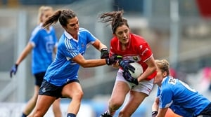 Cork's Ciara O'Sullivan with Niamh Collins of Dublin