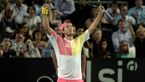 Lucas Pouille raises his hands in victory