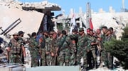 Syrian soldiers pictured after capturing Palestinian refugee camp, Handarat camp, north of Aleppo