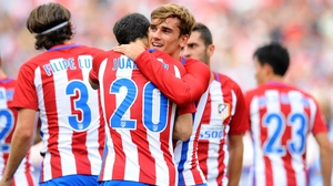 Antoine Greizmann celebrates with Juanfran